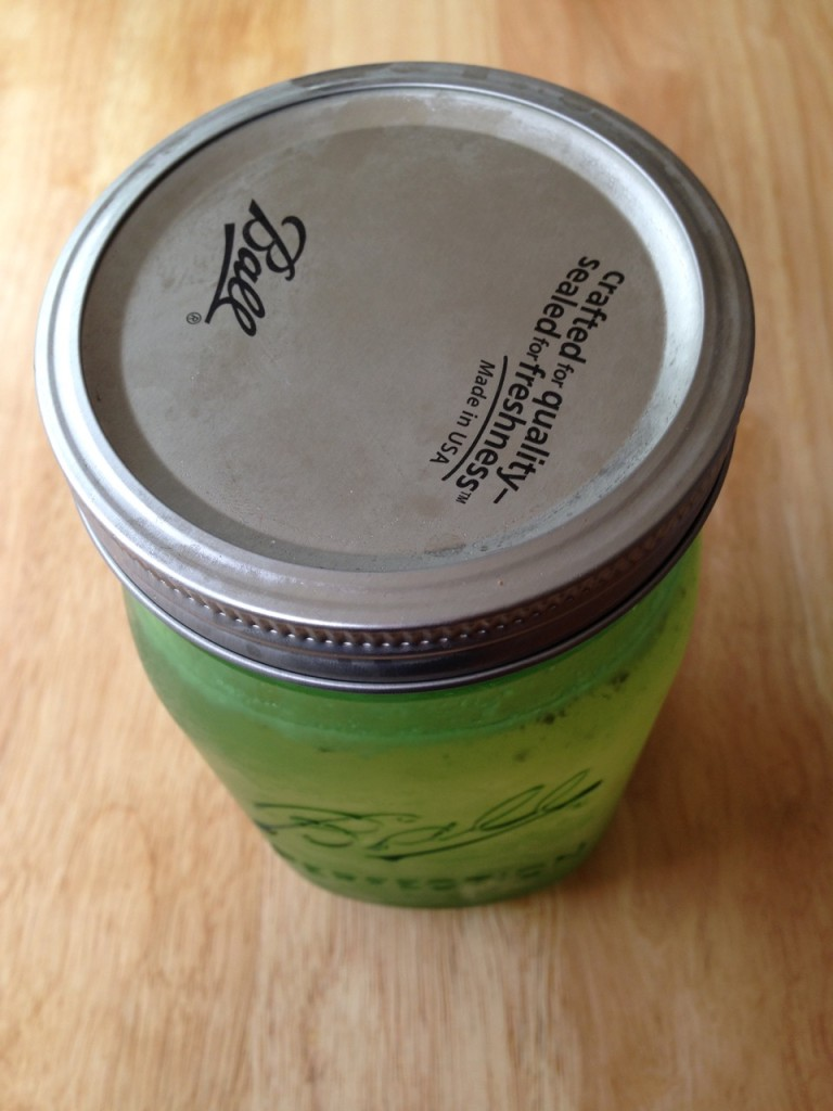 this is a green jar but you can see the top is sealed and indented